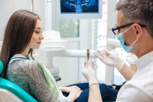 Dentist talk to patient about dnetal implants