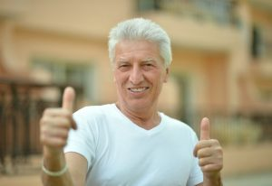 man smiling happy with new dental implants